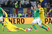 ROMANIA, Bucharest: Romania's Dragos Grigore (L) and Mihai Pintilii (R) and Northern Ireland's Kyle Lefferty (C) vie for the ball during the Euro 2016 Group F qualifying football match Romania vs Northern Ireland in Bucharest, Romania on November 14, 2014.