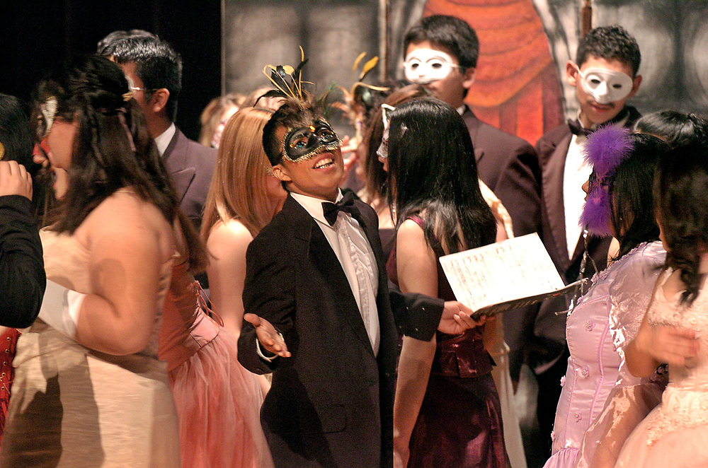 """Brownsville, Texas:  January, 2006:  Students perform Andrew Lloyd Webber's """"Phantom of the Opera"""" during a holiday show at Lopez High. ©Bob Daemmrich/"""
