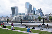 With the Coronavirus pandemic well into its fourth month people enjoy some outside time at More London, across the River Thames from the City of London as daily life continues but on far quieter streets on 2nd July 2020 in London, United Kingdom. Coronavirus or Covid-19 is a respiratory illness that has not previously been seen in humans. While much or Europe has been placed into lockdown, the UK government has put in place more stringent rules as part of their long term strategy, and in particular social distancing.