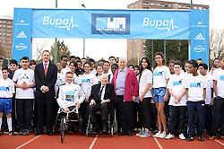 © Licensed to London News Pictures. 26/02/2014. © London News Pictures. 26/02/2014. London, UK. SIR ROGER BANNISTER, the first man to run a sub-four minute mile and DIANNE CHARLES (formerly Dianne Leather) the first woman to run a sub-five minute mile, at a photocall at Paddington Recreation ground in London to launch the 2014 Bupa Westminster Mile in May 2014, which will officially celebrate the 60th anniversary. The track at Paddington Recreation ground was where Sir Roger Bannister trained for the record attempt. Photo credit: Mike King/LNP