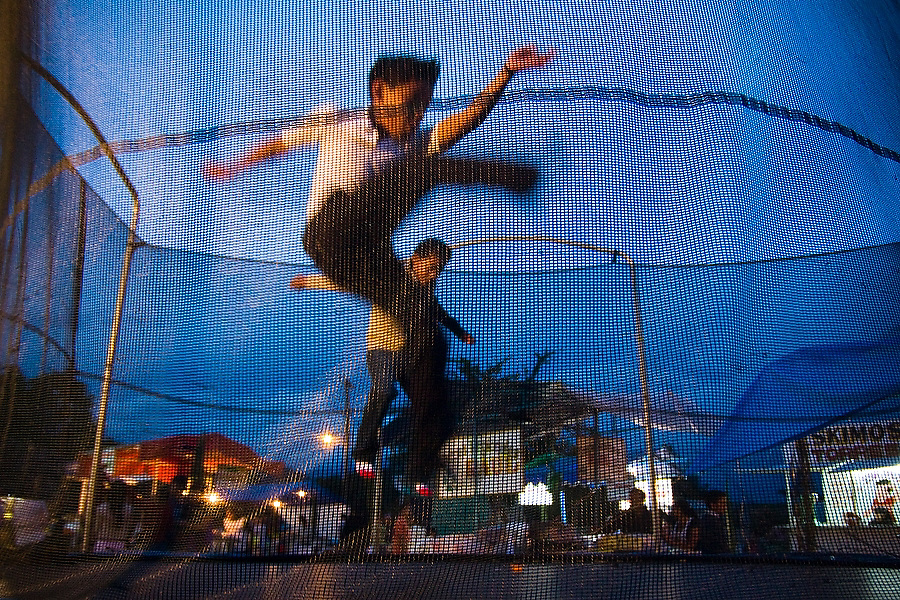 Children play on a trampoline during the annual patron saint festival for Santiago Matamoros in Cuilapan, Oaxaca, Mexico on July 25, 2008.