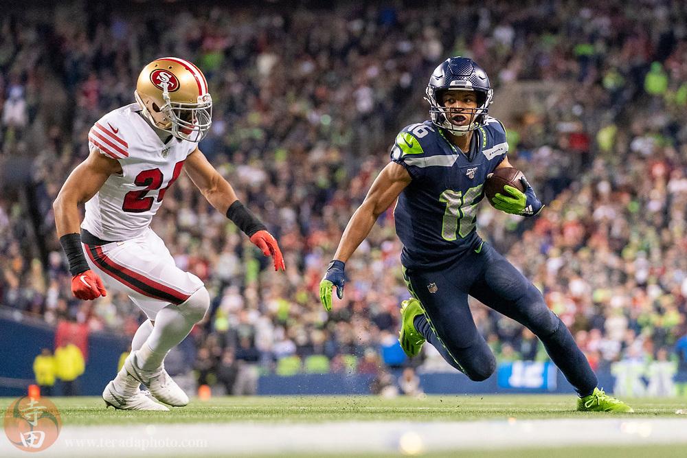 December 29, 2019; Seattle, Washington, USA; Seattle Seahawks wide receiver Tyler Lockett (16) runs against San Francisco 49ers defensive back K'Waun Williams (24) during the fourth quarter at CenturyLink Field.