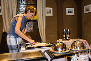 Eat a special dinner with a top Swiss sommelier (wine steward) at Hotel Alpenblick, Wilderswil, Switzerland, the Alps, Europe. For licensing options, please inquire.