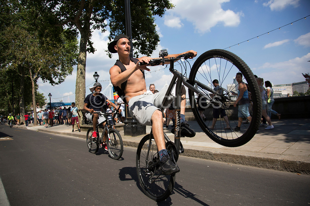 Thousands of cyclists from Bike Life block the street and wheelie their cycles along Victoria Embankment in London, England, United Kingdom. This was like a flash mob event, where suddenly the whole street was filled with bicycles that took over the streets. (photo by Mike Kemp/In Pictures via Getty Images)