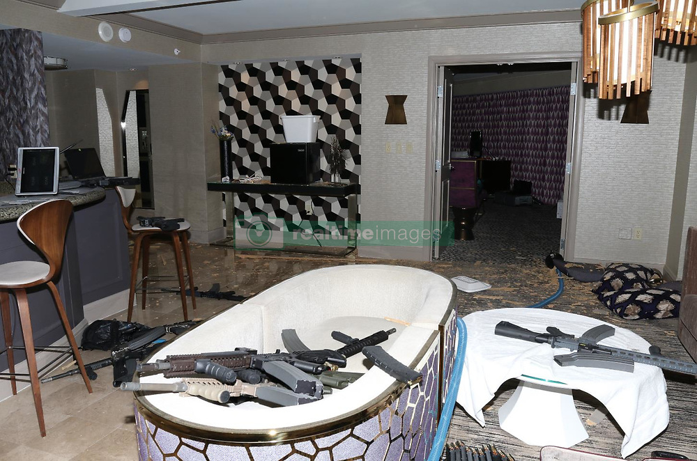 Investigators have released dramatic new photos of the Las Vegas hotel room from which Stephen Paddock murdered 58 people. Images show Paddock hid a camera in a food cart outside his room, as well as mounting one on the door's peephole, proving he was keeping an eye out for anyone trying to get into his room. There is a also a close up photo of the broken window through which he fired his assault rifles, which more images showing the guns and ammunition littered around his room. After unleashing a tirade of bullets on revelers at a music festival below, killing 58, Paddock committed suicide by shooting himself. The massacre, which happened on 17 October, 2017, is the deadliest mass shooting by a lone gunman in U.S. history. 23 Jan 2018 Pictured: View from sitting area towards master bedroom. Photo credit: LVMPD/ MEGA TheMegaAgency.com +1 888 505 6342