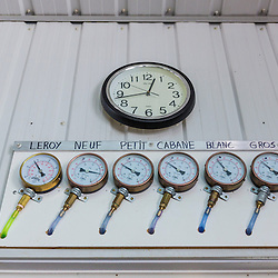 Gauges measure the pressure in the sap lines at the Rodrique family sugarhouse in Big Six Township, Maine.