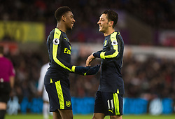 SWANSEA, WALES - Saturday, January 14, 2017: <br /> Arsenal's Alex Iwobi celebrates his second goal with Mesut Ozil against Swansea City during the FA Premier League match at the Liberty Stadium. (Pic by Gwenno Davies/Propaganda)