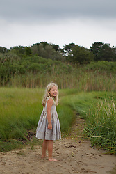 little girl walking on the beach in a pretty dress in East Hampton, NY