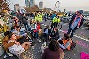 The police start issuing section 14 public order act warnings and then begin making arrests - Waterloo bridge is turned into a garden bridge - Protestors from Extinction Rebellion block several (Hyde Park, Oxford Circus, Piccadilly Circus, Warterloo Bridge and Parliament Square) junctions in London as part of their ongoing protest to demand action by the UK Government on the 'climate chrisis'. The action is part of an international co-ordinated protest.