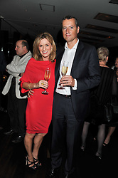 ANDREA CATHERWOOD and her husband GRAY SMITH at a party to relaunch the Met Bar at 19 Old Park Lane, London W1 on 5th October 2011.