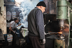 March 29, 2019 - Diyarbakir, Turkey - On March 22, 2019, an ironsmith shapes hot metal farming tools in the artisanal streets of the historic Sur district of Diyarbakir, a Kurdish-majority city in the southeast of Turkey. Roughly half of Sur's residential and commercial areas were destroyed during and after state military operations against Kurdish militants in 2015 and 2016, following the collapse of peace talks. In the spring of 2019, many of Sur's war-ravaged areas were being rebuilt by private construction companies with close ties to the ruling Justice and Development Party (AKP) (Credit Image: © Diego Cupolo/NurPhoto via ZUMA Press)