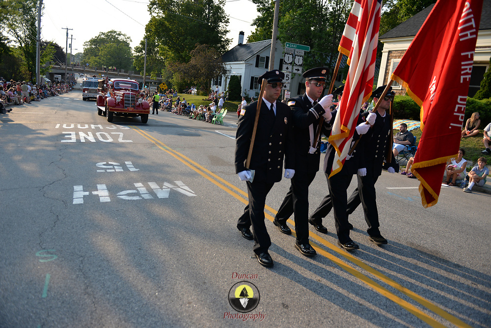 YARMOUTH, Maine --  7/21/17 --   The Yarmouth Fire Department honor guard leads the parade down Main St in Yarmouth on Friday night. The Yarmouth Clam Festival parade drew thousands of visitors from around the region. Photo by Roger S. Duncan for the Forecaster