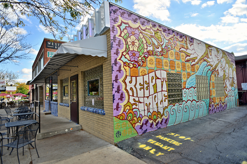 Street art mural on the outside wall of Angel Falls Coffee Company.