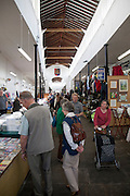 People browsing market stalls, The Shambles, Devizes, Wiltshire, England, UK