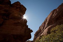 North America, United States, Utah, Arches National Park, Landscape Arch,  Devils Garden Trail, sunburst behind butte