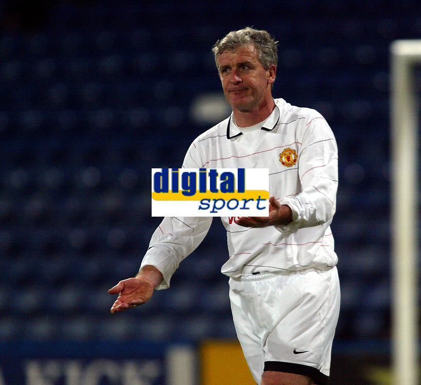 Photo: Chris Ratcliffe.<br /> Geoff Thomas Charity Event. Crystal Palace v Manchester United. 06/04/2006.<br /> Mark Hughes asks which direction he is going