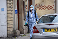 © Licensed to London News Pictures. 31/12/2018. West London, UK. Forensics arrive where a man in his 30s was left fighting for his life after being stabbed on Fulham Palace Road in an unprovoked attack in the early hours of New Years Eve. Police have arrested 39 individuals at a party at a near by address where the assailant ran to following the attack according to eye witnesses. Photo credit Guilhem Baker/LNP