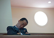NORTH KOREA:<br /> The pictures Kim Jong Un doesn't want you to see<br /> <br /> Since 2008, Eric Lafforgue ventured to North Korea six times. Thanks to digital memory cards, I was able to save photos that I was forbidden to take or was told to delete by the minders.<br /> <br /> Photo Shows:  In a Christian church, this official was dozing off on a bench. You must never show the officials in a bad light. Woops!<br /> ©Eric Lafforgue/Exclusivepix Media