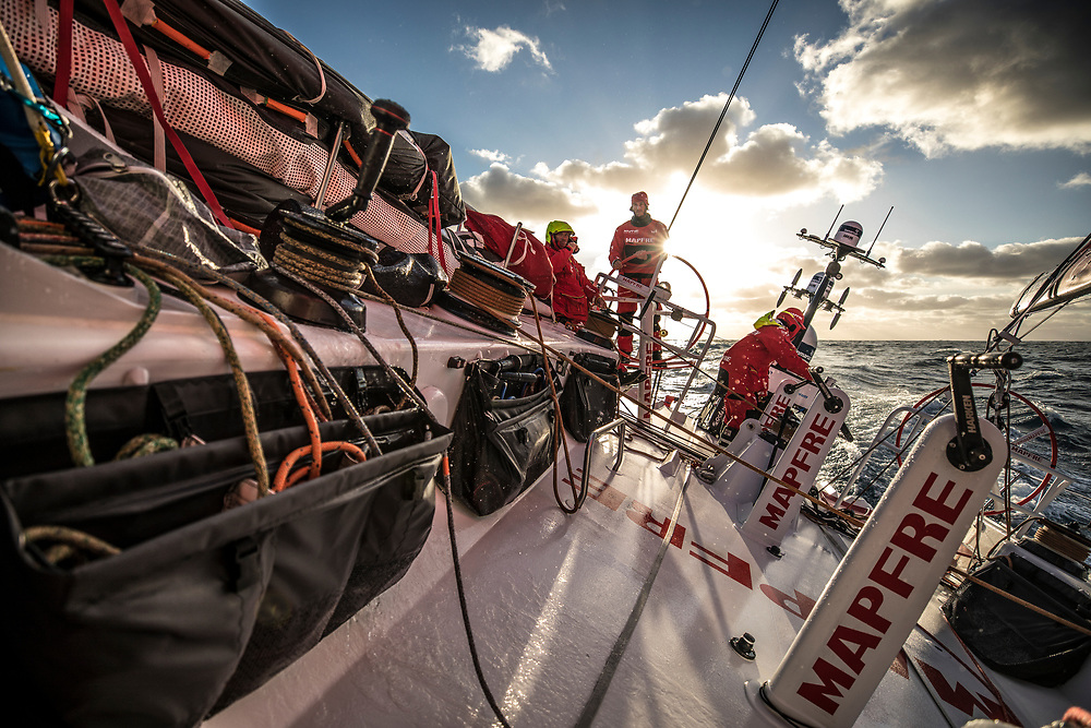 Leg 02, Lisbon to Cape Town, day 19, on board MAPFRE, A good sunset after three claudy days. Blair Tuke stearing, Tamara Echegoyen at the aft pedestal and Antonio Cuervas-Mons holding the main sheet . Photo by Ugo Fonolla/Volvo Ocean Race. 23 November, 2017
