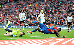 Wilfried Zaha of Crystal Palace falls over David De Gea of Manchester United - Mandatory by-line: Robbie Stephenson/JMP - 21/05/2016 - FOOTBALL - Wembley Stadium - London, England - Crystal Palace v Manchester United - The Emirates FA Cup Final