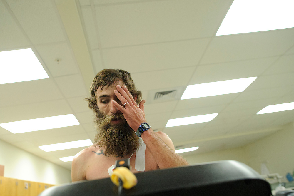 photo by Matt Roth.Wednesday, April 11, 2012..Ron Shriver catches his breath after participating in a VO2 Max test in the Gill Center's Human Performance Lab, Wednesday, April 11, 2012. The test is part of Ron's exercise science lab course. .Ron Shriver is a retired marine staff sergeant. He is also the first in his family to attend college, thanks to the New G.I. Bill. His wife, a fellow retired Marine, is finishing up graduate school in Alaska. After Ron gets his undergraduate degree from McDaniel College in May, he plans to drive to Alaska with is two children Rory, 6, and Miles, 5. For the move Ron got rid of most of his family's belongings, and after his lease was up, he and his children moved back into his parent's farmhouse.
