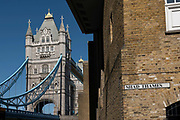 Shad Thames with Tower Bridge in the background on the 12th September 2019 in London in the United Kingdom. Shad Thames is a historic riverside street next to Tower Bridge in Bermondsey, London, England.