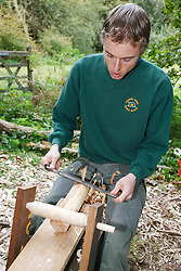 Ranger at Bestwood Country Park, Nottinghamshire, part of Sherwood Forest, demonstrating use of drawer knife and shave horse to prepare a billet to be turned on a pole lathe to turn green ie unseasoned wood: this craft was known as bodging.
