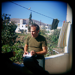 Reporter Martin Patriquin is seen interviewing subjects in Aytaroun, Southern Lebanon, Oct.23, 2006.