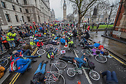 Outside the Treasury on the edge of Parliament Square - Stop Killing Cyclists stage a die-in to remember Anita Szucs, 30 and Karla Roman, 32 (both killed while cycling on Monday), and Ben Wales, 32. They are demanding investment in cycling and walking in the hope that it rises to 10% of the UK transport budget by the end of this parliament. They also point out that air pollution is poisoning millions of people in the UK and road danger means most people do not feel safe cycling on UK roads - meaning they miss out on healthy exercise and compounding a health disaster which the NHS will struggle to afford. They met outside the National Gallery and moved to the Treasury, Horse Guards Parade for protest.