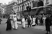 Procession of artists from the RA to St. james church, Piccadilly,  for a special service at the church, Non Members Varnishing Day, Royal Academy of art Summer Exhibition. Piccadilly. London. 31 Nay 2019