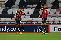 Football - 2020 / 2021 Sky Bet Championship - AFC Bournemouth vs. Wycombe Wanderers - The Vitality Stadium<br /> <br /> Bournemouth's Junior Stanislas and Bournemouth's Lloyd Kelly quiz each other over a mis understanding on the pitch during the Championship match at the Vitality Stadium (Dean Court) Bournemouth <br /> <br /> COLORSPORT/SHAUN BOGGUST