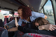April 1, 2016; Indianapolis, Ind.; Megan Mullings tries to take a selfie with assistant head coach Alysa Horn while the team rides to the Women's Final Four Salute at the Indianapolis Motor Speedway.
