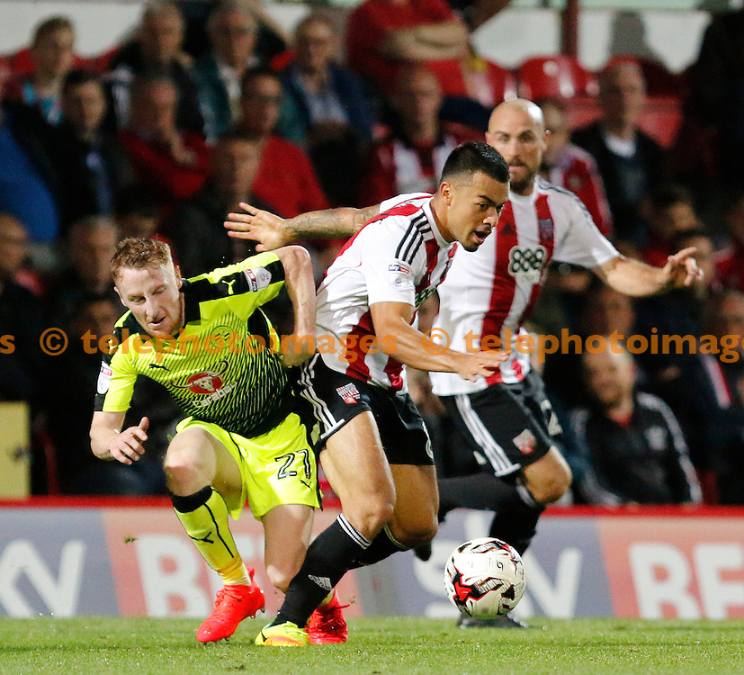 Brentford's Nico Yennaris is tackled by Reading's Craig Tanner during the Sky Bet Championship match between Brentford and Reading at Griffin Park in London. September 27, 2016.<br /> Carlton Myrie / Telephoto Images<br /> +44 7967 642437