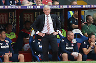 Mark Hughes, the Stoke City manager looks dejected after Scott Dann of Crystal Palace scores the 2nd goal.  Premier League match, Crystal Palace v Stoke city at Selhurst Park in London on Sunday 18th Sept 2016. pic by John Patrick Fletcher, Andrew Orchard sports photography.