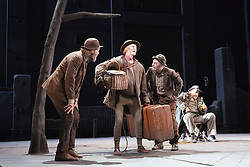 "© Licensed to London News Pictures. 05/06/2015. London, UK. L-R: Hugo Weaving as Vladimir, Luke Mullins as Lucky, Richard Roxburgh as Estragon and Philip Quast as Pozzo. Actors Richard Roxburgh and Hugo Weaving star in Samuel Beckett's ""Waiting for Godot"" at the Barbican Theatre. Part of the International Beckett Season, this Sydney Theatre Company play is directed by Andrew Upton. With Luke Mullins as Luke, Philip Quast as Pozzo, Richard Roxburgh as Estragon and Hugo Weaving as Vladimir. Performances from 4 to 13 June 2015 at the Barbican Theatre. Photo credit : Bettina Strenske/LNP"