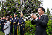 Jason Park performs TAPS during the Memorial Day Ceremony at City Hall in Milpitas, California, on May 25, 2015. (Stan Olszewski/SOSKIphoto)