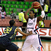Efes Pilsen's Bootsy THORNTON (R) and Fenerbahce Ulker's Tarence Anthony KINSEY (L) during their Turkish Basketball league Play Off Final first leg match Efes Pilsen between Fenerbahce Ulker at the Ayhan Sahenk Arena in Istanbul Turkey on Thursday 20 May 2010. Photo by Aykut AKICI/TURKPIX