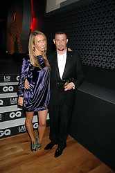 SAM TAYLOR-WOOD and ALEXANDER McQUEEN at the 10th annual GQ Men of the Year Awards held at the Royal Opera House, Covent Garden, London on 4th September 2007.<br />