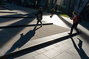 While office workers remain at home in accordance to government Covid guidelines and individual corporate policies, some homeward Londoners pass through sunlight during a quieter rush-hour in the City of London, the capital's financial district, during the third lockdown of the Coronavirus pandemic, on 9th March 2021, in London, England.