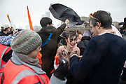 In solidarity with International Womens Day, climate activists from Extinction Rebellion brave the cold of a rain squall after two hours of freezing protest on their topless road block on Waterloo Bridge in protest of the disproportionate effects climate change has on women and girls, especially during times of specific climate crisis on 8th March 2020 in London, England, United Kingdom. Extinction Rebellion is a climate change group started in 2018 and has gained a huge following of people committed to peaceful protests. These protests are highlighting that the government is not doing enough to avoid catastrophic climate change and to demand the government take radical action to save the planet.