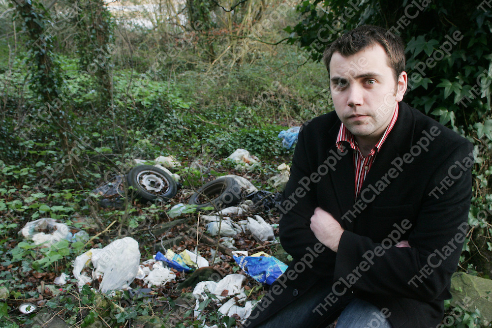 Cllr Cathal Crowe pictured with some of the rubbish being dumped at the Clare-Limerick border near Meelick, Clare on Thursday. Pic. Brian Arthur/ Press 22.
