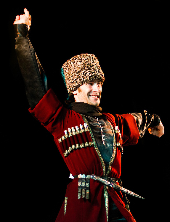 A male Chechen dancer performing at a folk dance festival in Tarcento, Italy.