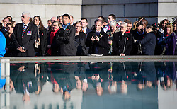 © Licensed to London News Pictures. 11/11/2016. London, UK. Members of the public attend Silence in the Square, a service held in Trafalgar Square, London to mark Remembrance Day. A minutes silence is held on the 11th hour of the 11th day of the 11th month, to recall the end of hostilities of World War I.  Photo credit: Ben Cawthra/LNP