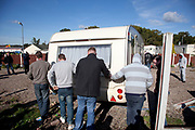 Travellers move a caravan at Dale Farm site prior to eviction. Riot police and bailiffs were present on 20th October 2011, as the site was cleared of the last protesters chained to barricades. Dale Farm is part of a Romany Gypsy and Irish Traveller site in Crays Hill, Essex, UK<br /> <br /> Dale Farm housed over 1,000 people, the largest Traveller concentration in the UK. The whole of the site is owned by residents and is located within the Green Belt. It is in two parts: in one, residents constructed buildings with planning permission to do so; in the other, residents were refused planning permission due to the green belt policy, and built on the site anyway.