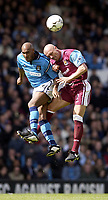 Manchester City v West Ham United, FA Barclaycard Premiership, Maine Road, Manchester. 27/04/2003.<br />West Ham's Tomas Repka (R) jumps with Man City's Nicolas Anelka.<br />Photo: Jed Wee, Digitalsport