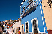 View of the colorful buildings along Positos Street in the historic center of Guanajuato City, Guanajuato, Mexico.