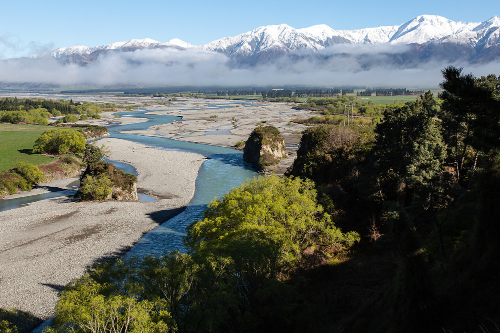View over the Waiau River looking towards snow capped Southern Alps