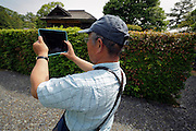 person using an Ipad as camera