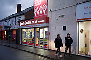 Business shop front for a payday loans company at night in the Kings Heath area of Birmingham, United Kingdom. Kings Heath is a suburb of Birmingham, three miles south of the city centre. It is the next suburb south from Moseley.