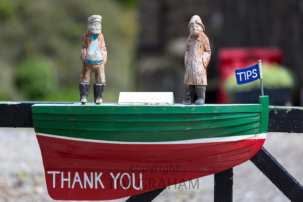Moneybox for tips for boatmen doing tourist boat trips on the Isle of Skye, Scotland